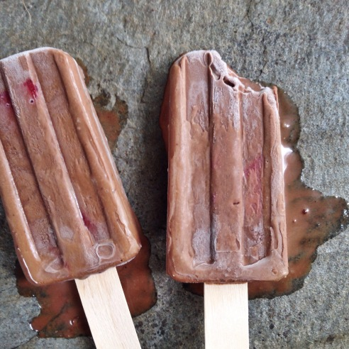 strawberry covered chocolate popsicle